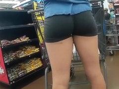 Girl in spandex black shorts at the supermarket