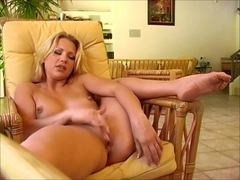 Cute blonde beating off on the sofa