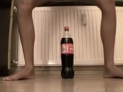 Small  immature tries to ride a coke bottle