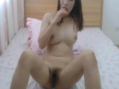 Hot Asian Chick Fingering Her Hairy Pussy