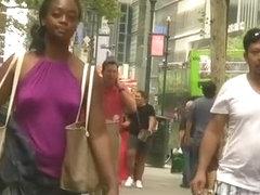 Ebony girl in purple top wearing no bra