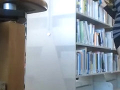 Female student makes upskirt selfie in library
