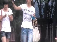 Asian tourist taking pee