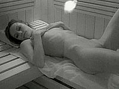 Slim chick naughty in a sauna
