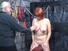 Bondaged redheaded bondman receives her titties clamped constricted