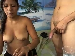 Latin babe eats cum blasts from a water cup on webcam