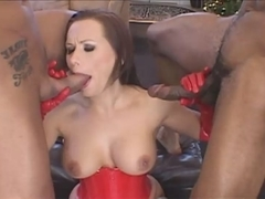 Slut in sexy red corset and boots takes two dicks