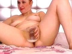 Tiffany_Adele masturbates and cums in a glass jar