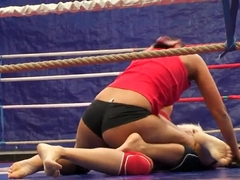 Brandy Smile wrestles with Lionses in the ring
