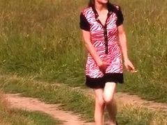 Teen pissing outdoor in grass