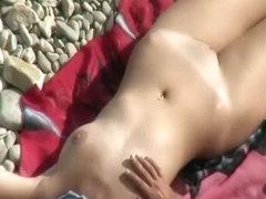 Nudist puts sun protection cream