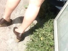 Tan Nylon Feet Play At the Bus Station