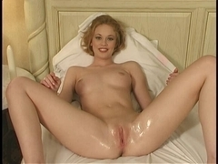 Beautiful busty blonde plays with a big dildo