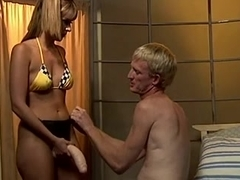 Sissy serf gets fucked by a strapon dick