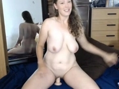 Milf with natural DD tits fucks self with dildos
