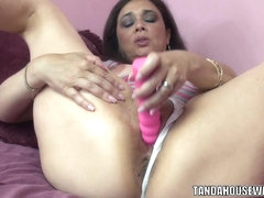 Busty brunette Alesia Pleasure bangs her mature pussy