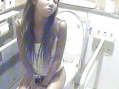 Hidden camera in women's bathroom spying on ladies peeing