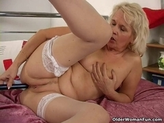 Granny in nylons copulates her snatch and wazoo with a sex-toy