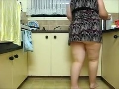 Bootylicious flabby slut poses on web camera in the kitchen