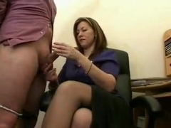 Sour faced British MILF wanks guy off
