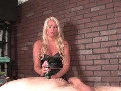 Mistress masseuse punishing sub with handjob