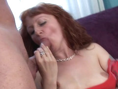 Redhead milf masturbates and does professional blowjob