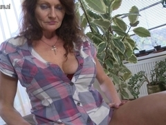 Large breasted granny getting juicy and wild