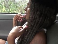Sexy busty black has fun on a back seat car