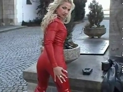 Latex glamour porn video with slut dressed in red