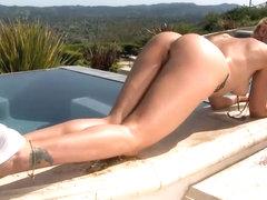 Fascinating blondie is stripping near pool
