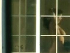 window peep on brunette