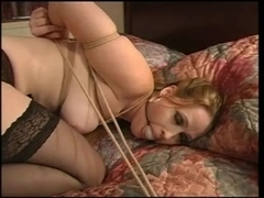 Julie Simone in stockings fastened on the couch for her masters enjoyment