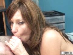 Aged tart Brandi Minx is on her knees blowing a geek