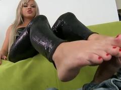 Blonde beauty giving footjob to her boyfriend