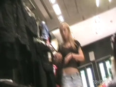 Scantily clad blondie spied on by an upskirt voyeur