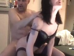 Tattooed chick rides dildo while sucks on her man's penis.