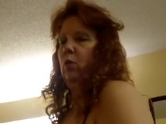 Redhead mommy sucking and fucking darksome dick