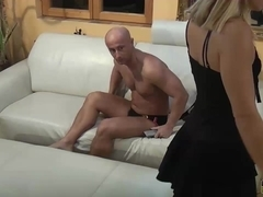 Wife feeds TV remote control and high heal shoe to husband