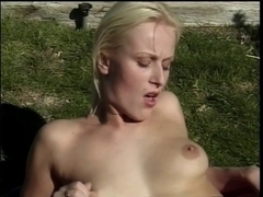 Scorching golden-haired receives drilled and facialized outdoors
