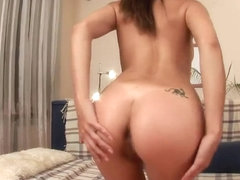 Young Monchi spreads her butt in front of the camera and sucks black dildo