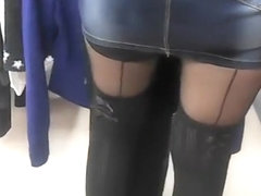 Upskirt on hot woman's shaved pussy