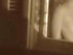 Man kissing the naked lover on window voyeur movie