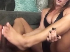 White girl gives an amazing footjob to bbc