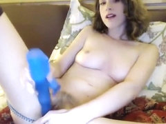 A Shaved Brunette With Blue Eyes Is Using Sex Toys