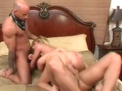 Buxom blonde Hillary has two dudes fucking her holes and covering her face with jizz