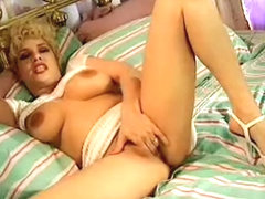 Dakota pleasures herself with a big dildo