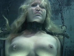 Restrained sub punished with water bondage