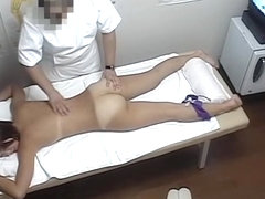Horny Asian female stretches hairy nub in massage parlor dvd 06