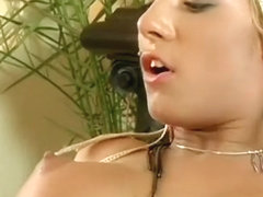 Busty blonde in fishnet stockings takes a huge black dick in her pussy