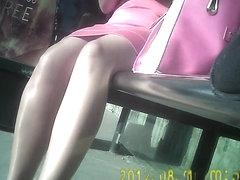 Sexy shiny tan pantyhose girl in bus stop